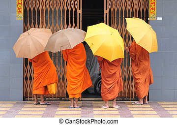 monks in cambodia - Monks on their daily tour in phnom penh