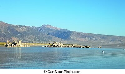 The popular calcareous tufa formation panorama on the smooth waters of Mono Lake, one of the oldest lakes in North America. The Mono Lake Tufa State Natural Reserve, California, United States.