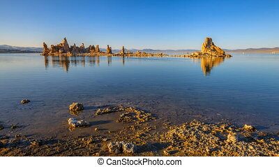 Mono Lake sunset - calcareous tufa formation reflects on the...
