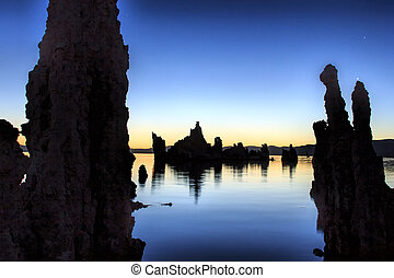 The silhouettes of the tufas at Mono Lake, California just before sunrise.