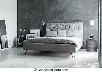 Monochromatic bedroom with mirror - Grey king-size bed in...