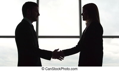 Monochrome Partnership - Silhouettes of business partners...