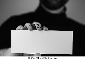 monochrome photo male hands holding a white sheet of paper happy