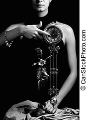 Monochrome picture of a clock and beautiful young girl (focus on clock)