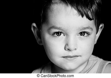Monochrome portrait of young boy