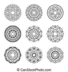 Monochrome set of vector mandalas in tribal style.