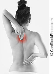 Monochrome Studio Shot Of Woman With Painful Back