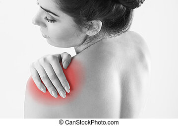 Monochrome Studio Shot Of Woman With Painful Shoulder