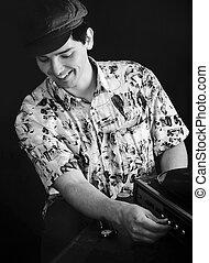 Monochrome Vintage Portrait Of A Man In A Cap