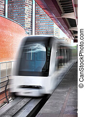Monorail fast train on railway, close-up