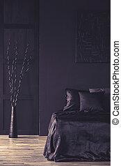 Monotone black bedroom interior - Metal sculpture next to ...
