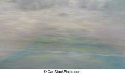 """Monotonous view through intercity bus window, public..."
