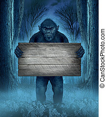 Monster holding a rustic blank old wood sign as a creepy halloween concept with a werewolf lurking as a bigfoot creature coming out of a dark scary background with a moon glow behind it as a horror symbol of a haunted woods animal.