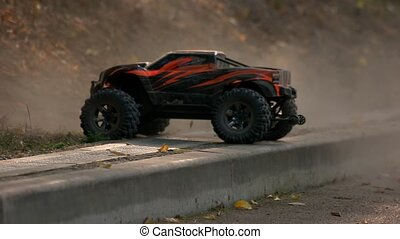 Monster truck car climbs uphill. Remote control car drives ...