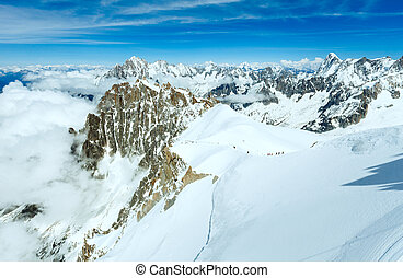 Mont Blanc mountain massif summer landscape (View from Aiguille du Midi Mount,  French.  All people are unrecognizable