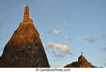The Chapel built on the top of a needle of volcanic lava, called Rocher St Michel ( Mont d'Aiguilhe ) is one of the most impressive sights in the Auvergne, France