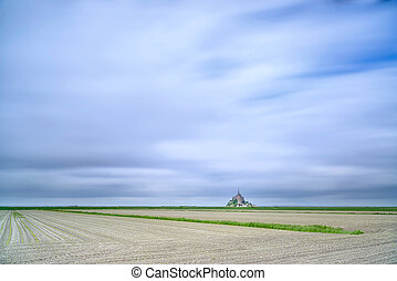 Mont Saint Michel monastery landmark and field. Unesco heritage site. Normandy, France, Europe. Long exposure photography