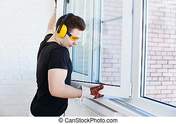 montage, venster, arbeider, man