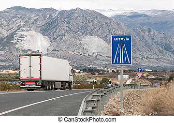 Highway and signs among mountains near Granada, Spain