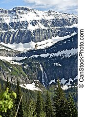 Montana Rocky Mountains in Early Summer. Snowy Rocky...