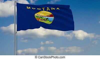 Montana State flag in wind against cloudy sky