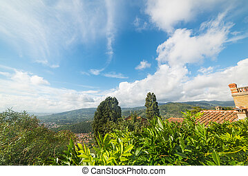 Montecatini under a blue sky with clouds