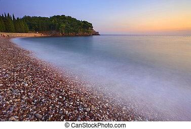 Montenegro beach at sunset, summer season.
