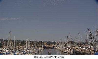 Monterey Harbor tilt down - Tilt down from blue sky to LS of...