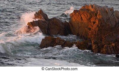 Monterey Surf Rocks Loop - Ocean waves roll in and break on...