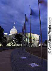 Flaggs of 50 states in fronts of State Capitol of Alabama in Montgomery.