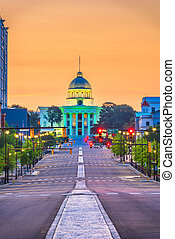 Montgomery, Alabama, USA downtown cityscape with the State Capitol at dawn.