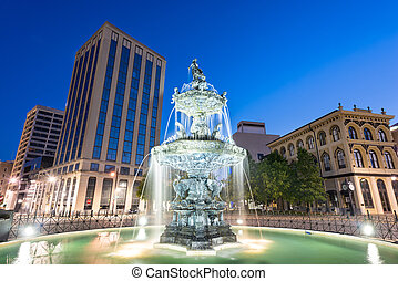 Montgomery, Alabama, USA fountain and downtown cityscape at twilight.