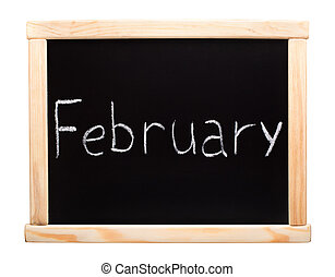 Month February written with chalk on blackboard