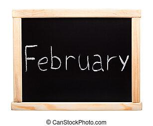 Month February written with chalk on blackboard