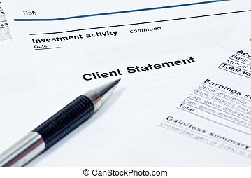 Monthly financial statement with pen