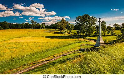 Monument and fields at Antietam National Battlefield,...