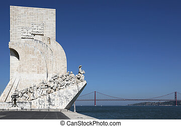 Monument for the discoverers with a suspension bridge in Belem in Lisbon Portugal