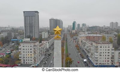 Monument golden star aerial drone view flying around camera movement Victory Square Kiev Ukraine