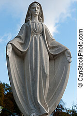 Monument Lady of Guadalupe on a cemetery