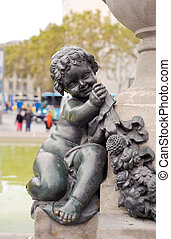 Monument of a child on the fountain