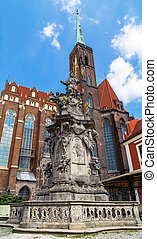 Monument of St. John of Nepomuk and the Church of St. Bartholomew and the Holy Cross in Wroclaw. Poland