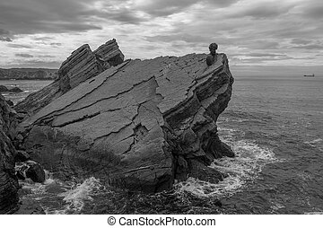 Monument on the rocks by the sea of Philippe Cousteau, Gijon, Spain
