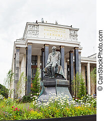 Monument to famous russian writer Dostoevsky F.M. in front of Russian State Library. Moscow, Russia.