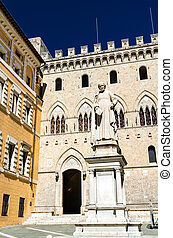 Monument to Sallustio Bandini and Palazzo Salimbeni in Siena, Italy