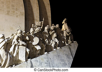 Monument to the Discoveries illuminated at night, Lisbon Portugal