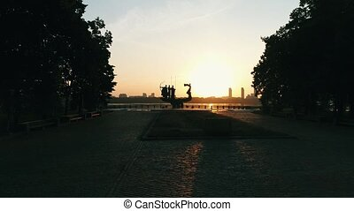 Monument to the founders of Kyiv at sunrise, beautiful...