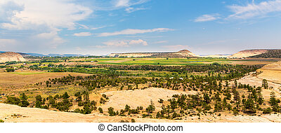 Monument valley landscape with blue sky.
