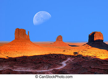 Monument Valley Moon - Sunset Large moon over Monument...