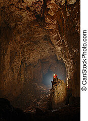 Monumental cave hall with a caver