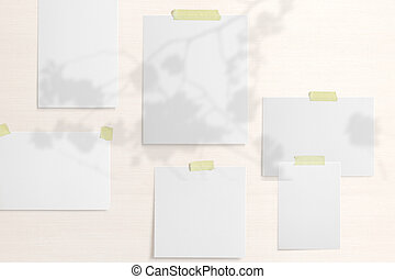 Moodboard template composition with blank photo cards, polaroid frame glued with yellow adhesive tape on textile background with floral shadow overlay.